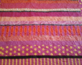 twin size pink and orange quilt