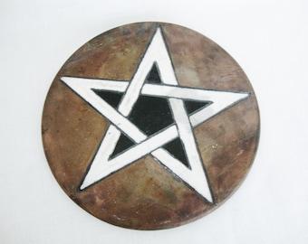 vintage raku star pottery trivet