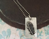 hope is the thing with feathers. necklace