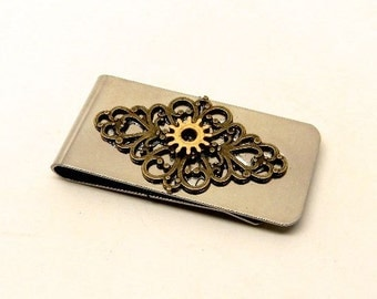 Steampunk jewelry money clip with brass gears.