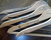 Set of 11 vintage wooden hangers - all with names of tailors or hotels