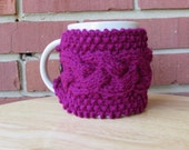 Cable knitted mug cozy cup cozy in dark raspberry with coconut wood button