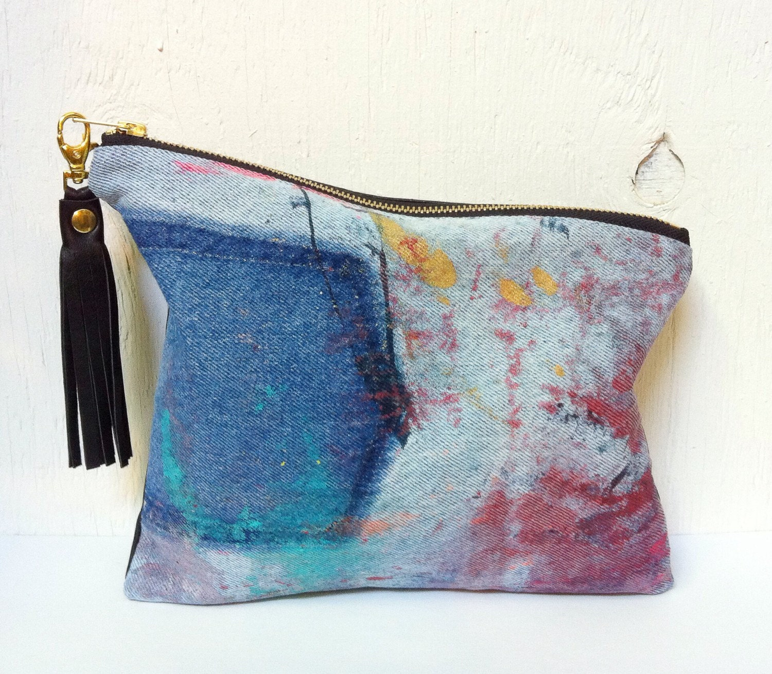 upcycled asymmetrical denim clutch  abstract art  hand