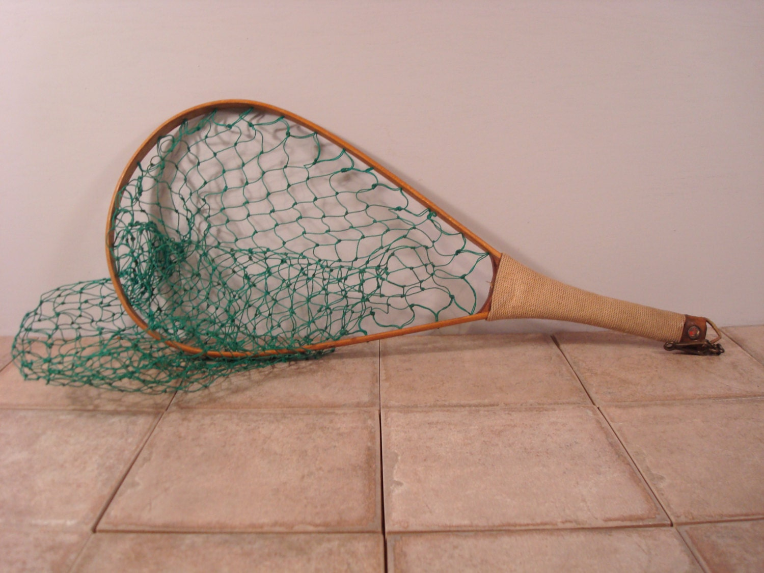 Beautiful vintage fish net with wood handle wrapped in cord for Wooden fishing net