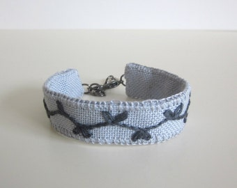 Bracelet, grey fabric cuff, hand embroidered with leaf design, boho style textile jewellery