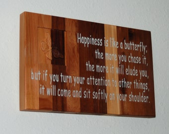 Happiness is like a butterfly, the more you chase it the more it will elude...  Wood sign   15068