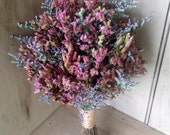 Simple Bride or bridesmaid's bouquet made with dried Santa Cruz Oregano and Limonium. Handle wrapped in twine.