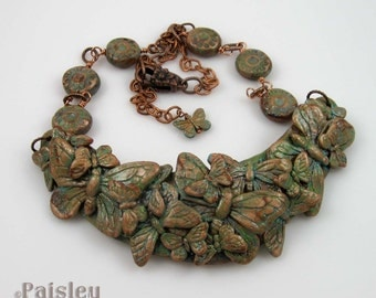 Copper Patina Butterfly Bib Necklace, polymer clay collage and beads on copper chain, adjustable length