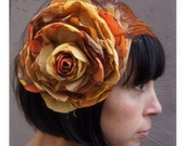 Orange and gold recycled vintage silk satin rose flower fascinator headpiece with feather wing