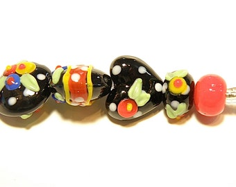 DESTASH -- Seven Coordinating Lampwork Beads: Primary Colors and Black Flower and Heart Set - Lot UU