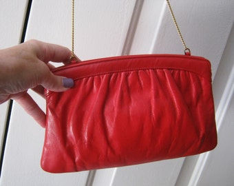 Vintage small red leather clutch or shoulder bag, red Morris Moskowitz leather pouchy bag, swivel hinge red small clutch bag