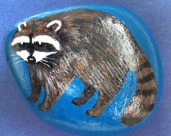 Raccoon painted rock paperweight