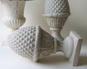 two cement finials