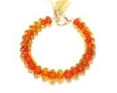 Wooden and yellow red glass beaded golden tassel bracelet