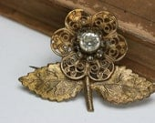 Vintage Gold Tone Metal and Clear glass Stone Flower Brooch