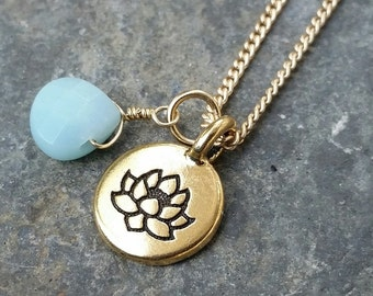 Sky blue drop and gold lotus charm necklace