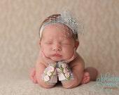 Baby in Paris, newborn photography, newborn headband and lace arm cuffs