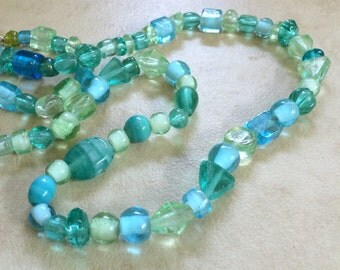 Shades of  Aqua Blue Green in a Mix of Shapes  Glass Beads 10 inches