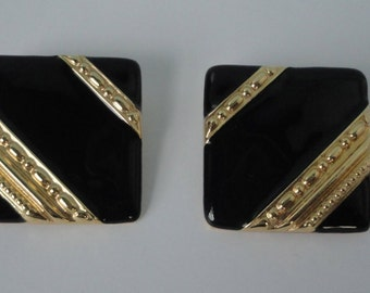 GIVENCHY Gold tone and Black Enamel Clip Earrings.