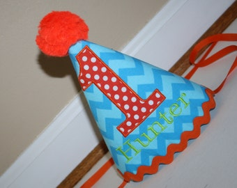 baby boys birthday party hat,  boys 1st birthday hat, turquoise blue chevron with orange number and lime green name, cake smash hat