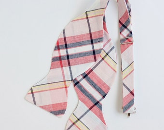 The Beau- men's coral, blush, and navy organic madras plaid freestyle self-tie bow tie (comes with tying instructions)