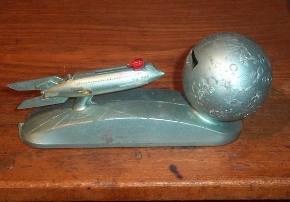 Mechanical coin bank rocket ship to the moon strato duro mold 1950s - Rocket piggy bank ...