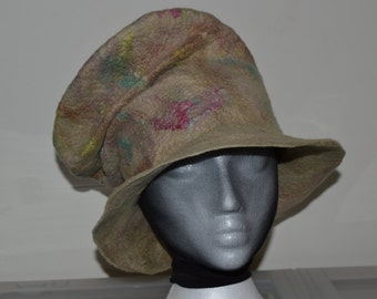 Wide brim sculpted bucket hat fashioned of  merino wool and silk mawata, hand dyed and wet felted