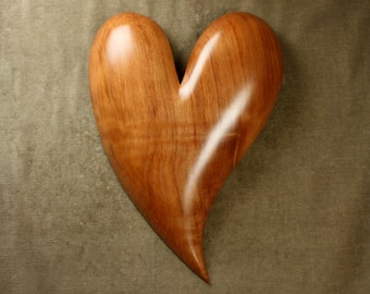A personalized carved wooden heart shaped Anniversary gift present