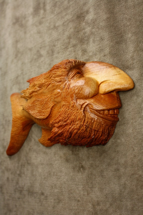 A perfect loving carved fish wood carving by