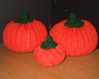 3 crocheted pumpkins