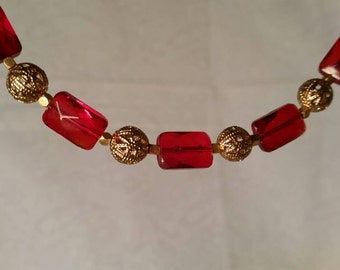 Red and gold choker necklace