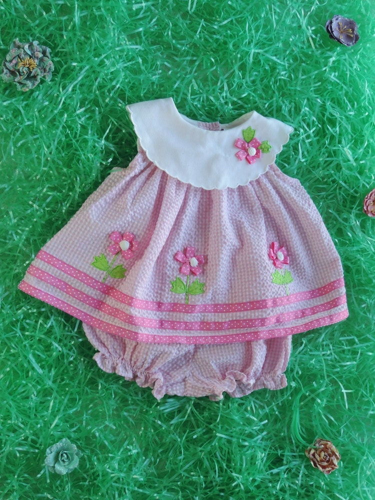 This sweet Easter dress for baby girl is certainly great for birthdays or any special occasion. This cute infant baby dress features a sleeveless bodice in rich lace overlay. The waist is highlighted with an adorable flower with crystal sparkling in the center finishing with tie back sash.