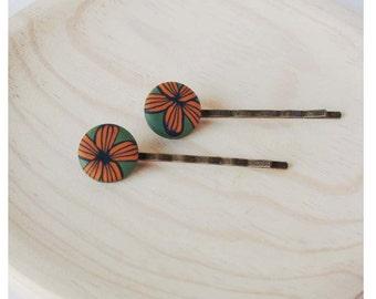 Orange flower hairpins
