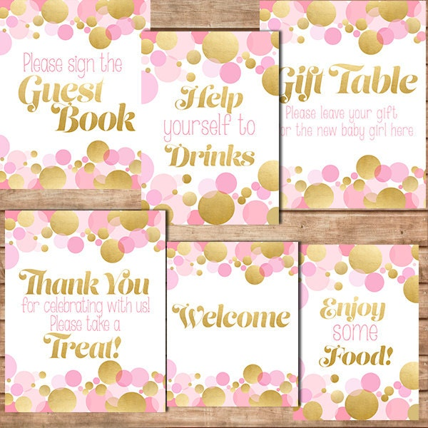 baby shower table sign in pink and gold drinks food