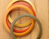 Vintage 40's Bakelite Spacer Bangles in Yellow, Orange, Yellow Orange, and Olive