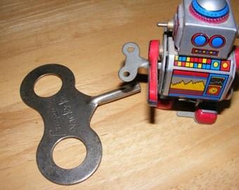 Giant key for a wind up toy, Cragston brand Wacky key, vintage key
