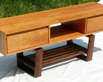 Mid century modern styled TV stand with drawers.