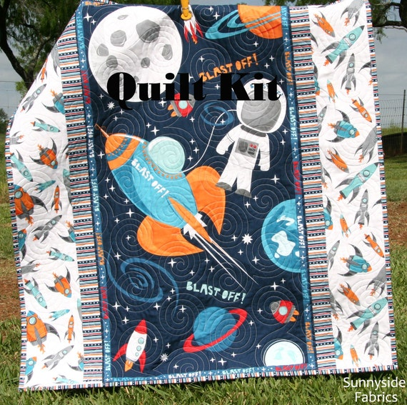 Boy quilt kit blast off wilmington fabrics space for Space fabric quilt