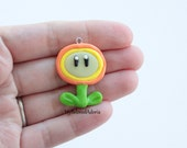 Polymer Clay Charm- Mario's Fire Flower- Glows in the Dark- Ready to Ship