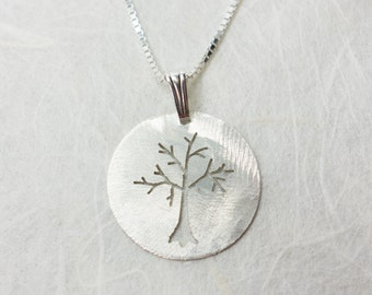 Round sterling silver tree pendant