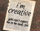 Art Print: 'I'm creative' quotation on a repurposed (broken dictionary) book page