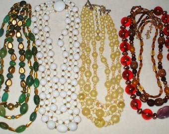 4 Vintage Triple strand glass beaded necklaces, signed Hong Kong