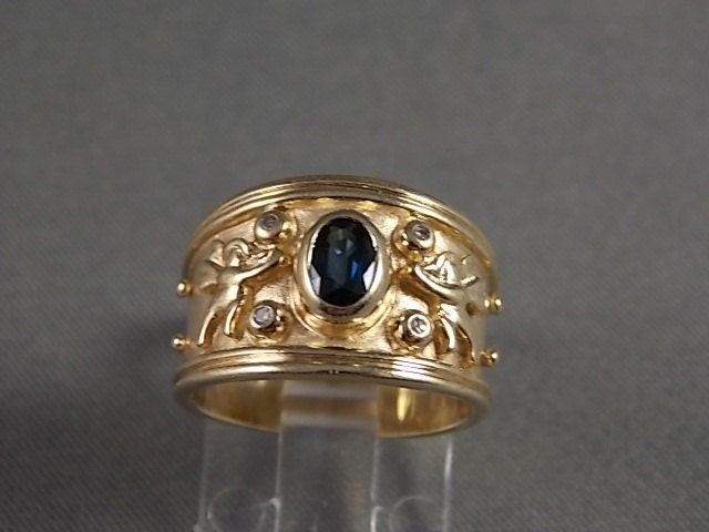 sapphire and cigar band ring with design 60ctw