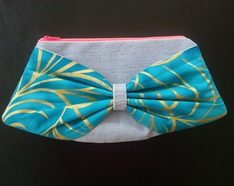 Mini Bow Clutch - Recycled Denim Jeans Body with Teal and Gold Swirl Pattern Bow, Yellow, Grey, and White Paisley Lining, Neon Pink Zipper