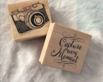 "Wooden and rubber Stamps set of 2 decorative quote ""capture every moment"" and a camera image"
