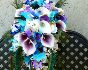 Cascading bridal bouquet, picasso callas, turquoise, champagne ivory hydrangeas, real touch calla lilies, purple blue orchids