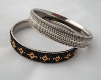 Stainless steel channel bangle bracelet with seed bead beadwoven inlay.