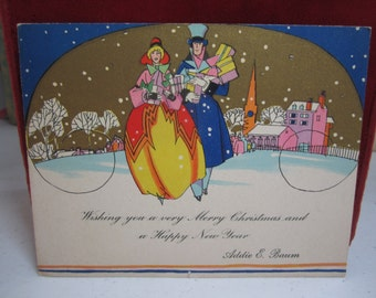 Colorful 1920's-30's art deco gold gilded christmas card victorian man and woman in colorful attire carrying many gifts , village,church