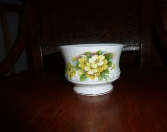 Royal Minster fine bone china sugar bowl 2.5 inches high with yellow dog roses and green foliage on a ribbed pattern.