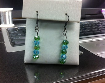 Blue and green sparkly faceted glass beads on earrings